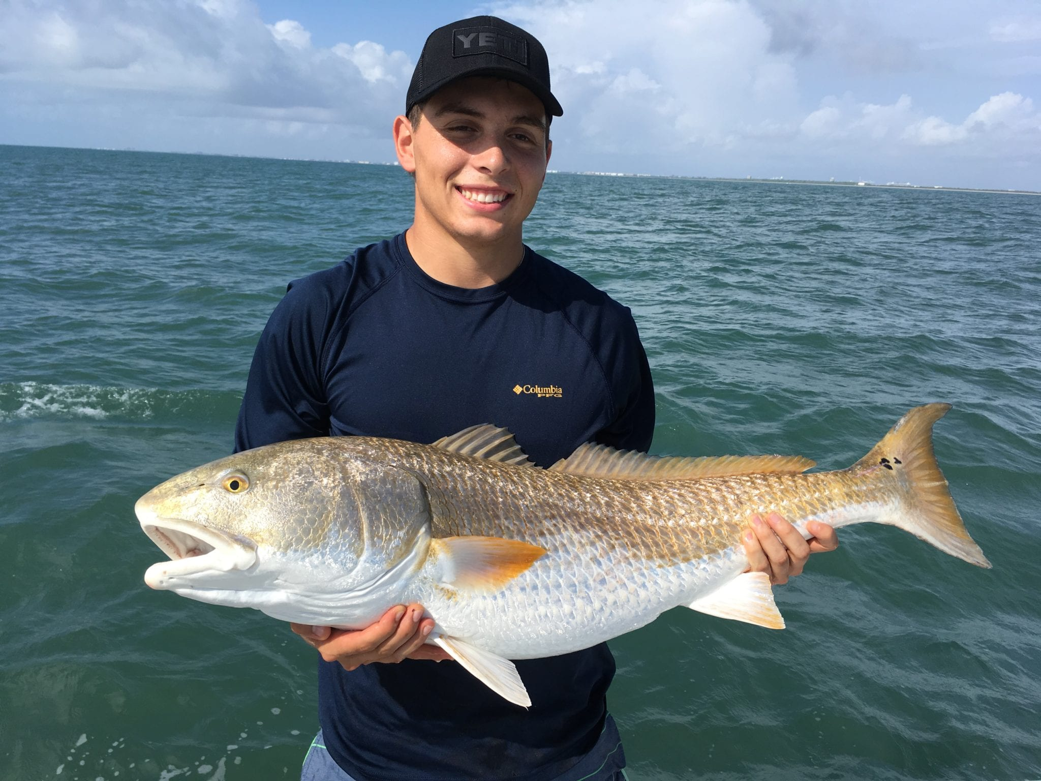 orlando fisherman with redfish